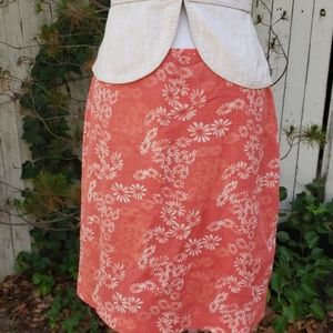 Orange flowered skirt
